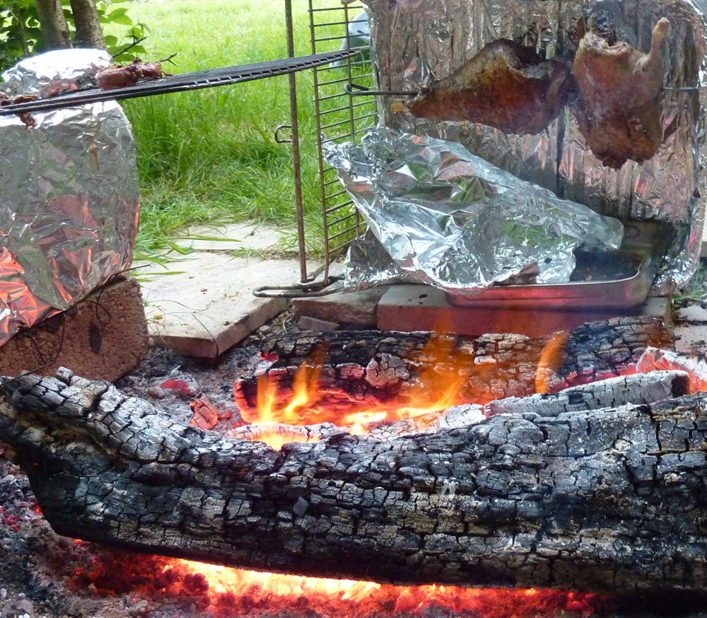 Real wood fire, leg of lamb, whole duck with improvised reflectors and drip tray